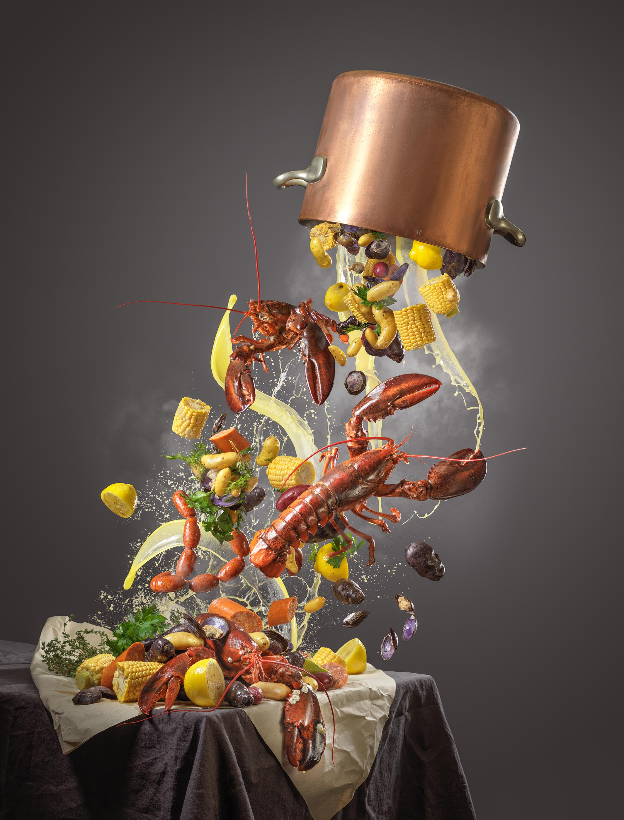 Lobster Clam Bake Splash | Steve Hansen Seattle Food Photographer